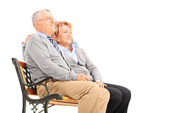 Senior couple hugging and looking in the distance Royalty Free Stock Photos