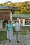 Senior couple hugging near  hotel Royalty Free Stock Photography
