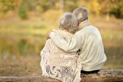Senior couple hugging  outdoors. Portrait of sad senior couple hugging outdoors Stock Image
