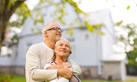Senior couple hugging over living house background Royalty Free Stock Images