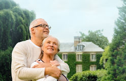 Senior couple hugging over living house background Royalty Free Stock Photo