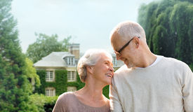 Senior couple hugging over living house background Stock Images