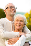 Senior couple hugging in park Stock Photos
