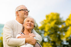 Senior couple hugging in park. Family, age, tourism, travel and people concept - senior couple hugging in park Royalty Free Stock Image