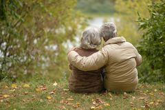 Senior couple hugging   in the park Royalty Free Stock Photography