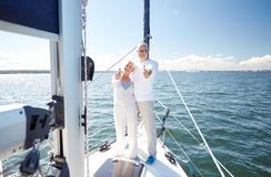 Senior couple hugging on sail boat or yacht in sea Stock Photo