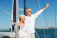 Senior couple hugging on sail boat or yacht in sea. Sailing, age, tourism, travel and people concept - happy senior couple hugging on sail boat or yacht deck royalty free stock photos