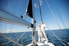 Senior couple hugging on sail boat or yacht in sea Stock Images