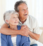 Senior couple hugging on their bed Royalty Free Stock Images