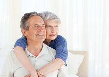 Senior couple hugging on their bed Royalty Free Stock Photo