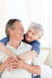 Senior couple hugging on their bed Stock Image
