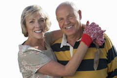 Senior couple hugging, wearing gardening gloves, cut out royalty free stock images