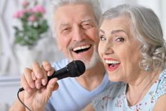 Senior couple husband and wife singing songs. Portrait of senior couple husband and wife singing songs stock photo