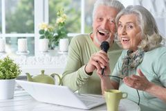 Senior couple husband and wife singing songs. Portrait of senior couple husband and wife singing songs royalty free stock photos