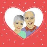Senior couple inside heart shaped frame Royalty Free Stock Photos
