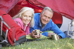 Senior Couple Inside Tent On Camping Holiday stock photography