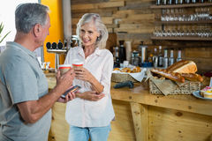 Senior couple interacting with each other while having coffee Royalty Free Stock Image