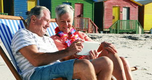 Senior couple interacting with each other while using digital tablet stock video footage