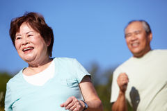 Senior couple jogging Stock Image