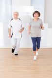 Senior Couple Jogging At Gym Royalty Free Stock Image