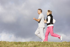 Senior Couple Jogging In The Park Royalty Free Stock Images