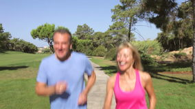 Senior Couple Jogging In Park stock video