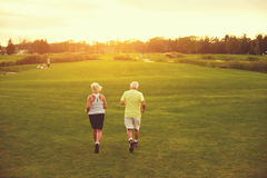 Senior couple is jogging. Stock Photography