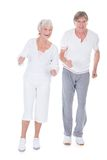 Senior couple jogging Stock Photo