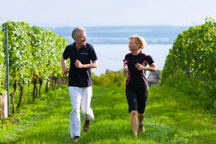 Senior couple jogging for sport Stock Photos