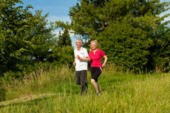 Senior couple jogging for sport Royalty Free Stock Photography