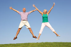 Senior couple jumping in air Royalty Free Stock Images