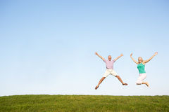 Free Senior Couple Jumping In Air Stock Photo - 17062920