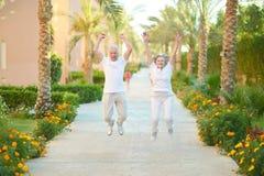 Senior couple jumping Royalty Free Stock Image
