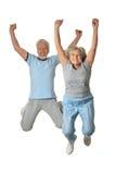 Senior couple jumping Stock Photo