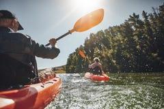 Senior couple kayaking in a lake Royalty Free Stock Image