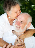 Senior Couple - Kiss for Husband Stock Images