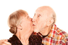 Senior couple kissing Stock Images