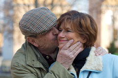 Senior Couple kissing Stock Photo