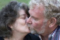 Senior Couple Kissing royalty free stock photography