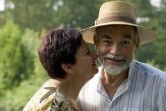 Senior couple kissing royalty free stock photos