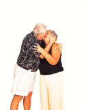 Senior couple kissing. An happy senior couple kissing in front of the camera Stock Images