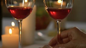 Senior couple kissing after glass of wine, romantic anniversary date, closeup. Stock footage stock video