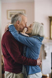 Senior Couple Kissing. Senior couple are kissing on the lips in their home Royalty Free Stock Images