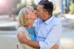 Senior Couple Kissing. Loving Senior Couple Outdoors Kissing Stock Image