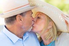 Senior Couple Kissing. Loving Senior Couple Outdoors Kissing Stock Photos