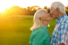 Senior couple is kissing. Man with women outdoor. Best husband in the world. Love and tenderness Stock Photos