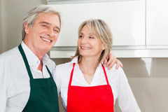 Senior couple in kitchen Stock Photos