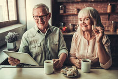Senior couple in kitchen royalty free stock photos