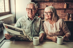 Senior couple in kitchen stock photography