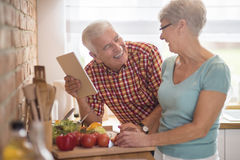 Senior couple at the kitchen. Funny things found in the Internet Stock Photos